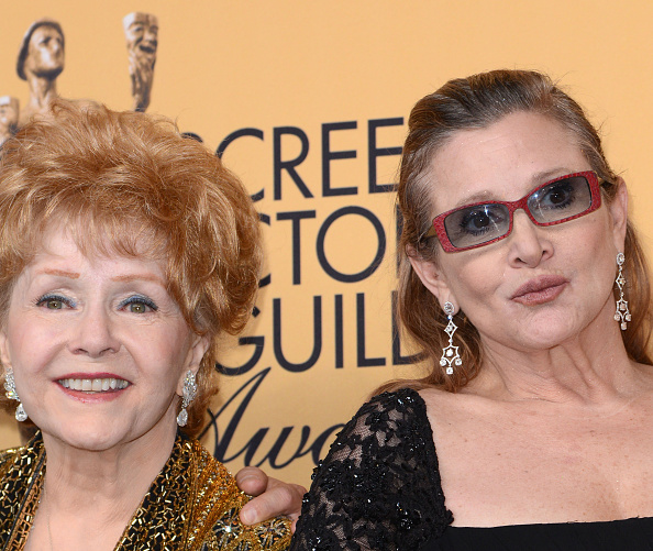 LOS ANGELES, CA - JANUARY 25: Actresses Debbie Reynolds (R), recipient of the Screen Actors Guild Life Achievement Award, and her daughter Carrie Fisher pose in the press room during the 21st Annual Screen Actors Guild Awards at The Shrine Auditorium on January 25, 2015 in Los Angeles, California. (Photo by C Flanigan/Getty Images)