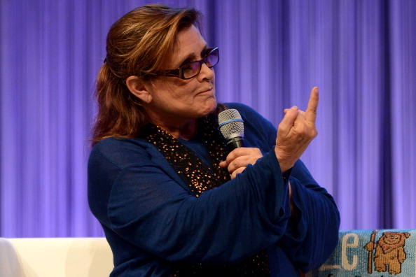ESSEN, GERMANY - JULY 27: Actress and novelist Carrie Fisher, best known for her performance as Princess Leia in the original Star Wars trilogy, gestures during the Star Wars Celebration at Messe Essen on July 27, 2013 in Essen, Germany. (Photo by Sascha Steinbach/Getty Images)