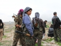 263e661400000578-2975783-ypj_fighters_chat_among_themselves_following_the_successful_libe-a-131_1425314100926
